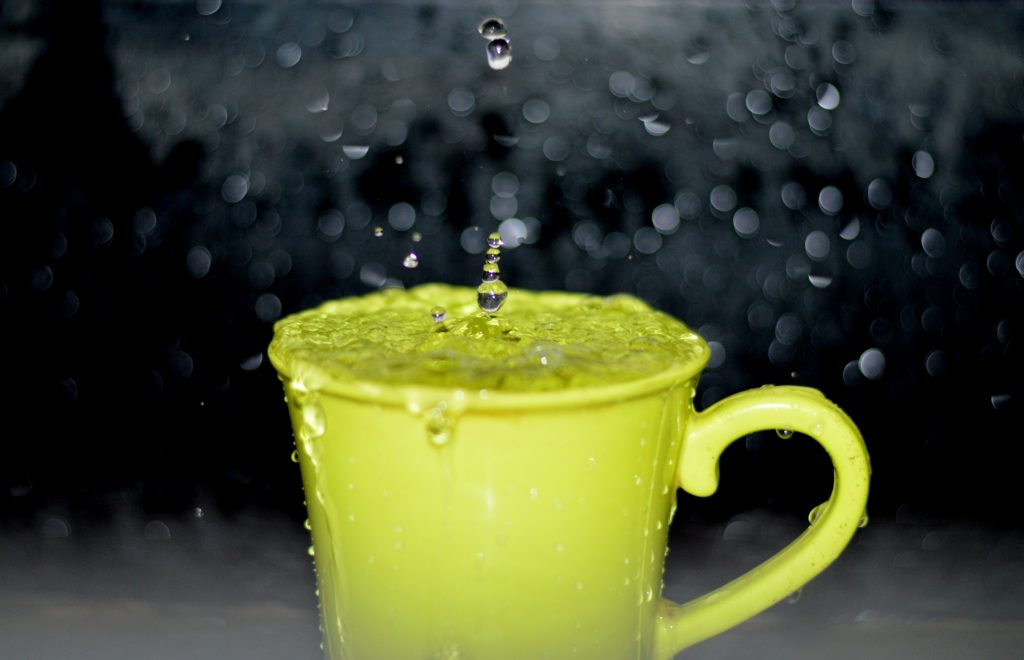 mug with water dropping into it