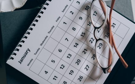Calendar with glasses resting on top